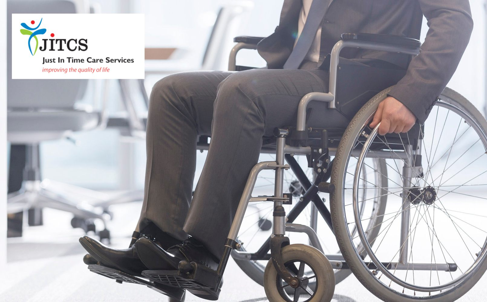 Low section of businessman in wheelchair in office